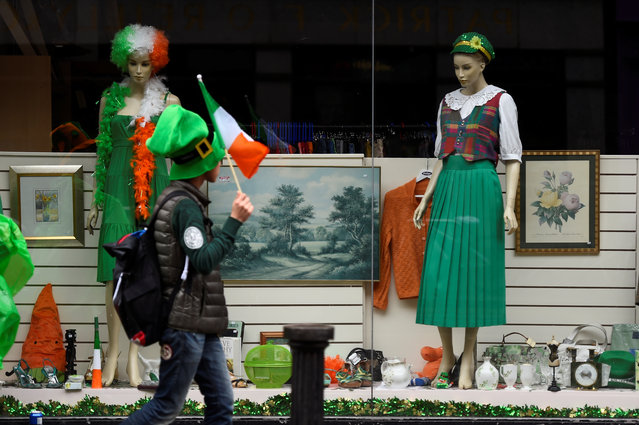 A man walks past a decorated shop front during the St. Patrick's day parade in Dublin, Ireland on March 17, 2017. (Photo by Clodagh Kilcoyne/Reuters)