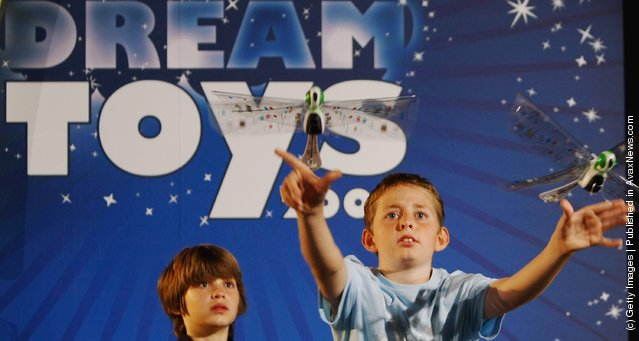 A young boys plays with remote control Flytech Dragonfly toys during the Dream Toys 2007 Christmas predictions fair