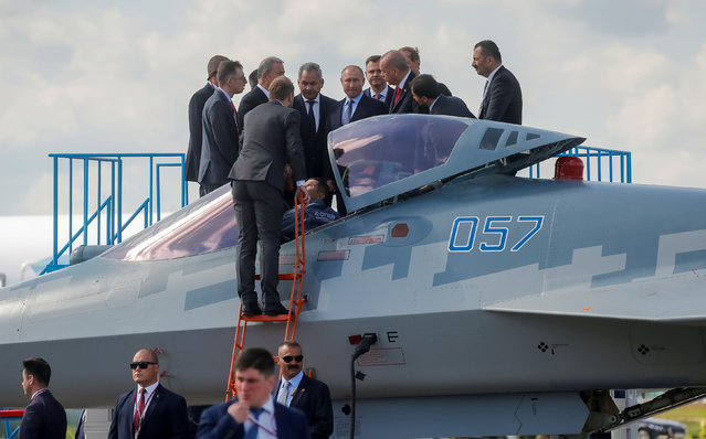 Russian President Vladimir Putin and his Turkish counterpart Recep Tayyip Erdogan talk next to a Sukhoi Su-57 fighter jet as they visit the MAKS 2019 air show in Zhukovsky, outside Moscow, Russia, August 27, 2019. (Photo by Maxim Shemetov/Reuters)