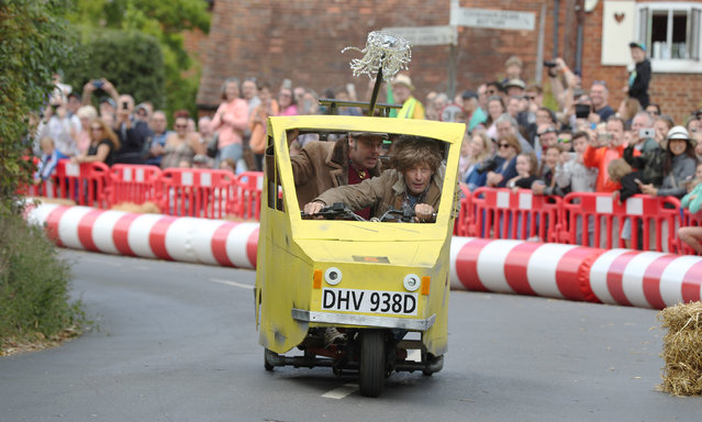 Competitors who modeled their kart on the Trotters' Reliant Robin take part in the Gravity Grand Prix, a fundraising downhill kart race in Cookham Dean, Berkshire, England on September 1, 2019. (Photo by Jonathan Brady/PA Images via Getty Images)