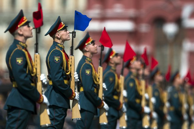 A Russian honor guard stand during the Victory Day military parade marking 71 years after the victory in WWII in Red Square in Moscow, Russia, Monday, May 9, 2016. (Photo by Pavel Golovkin/AP Photo)