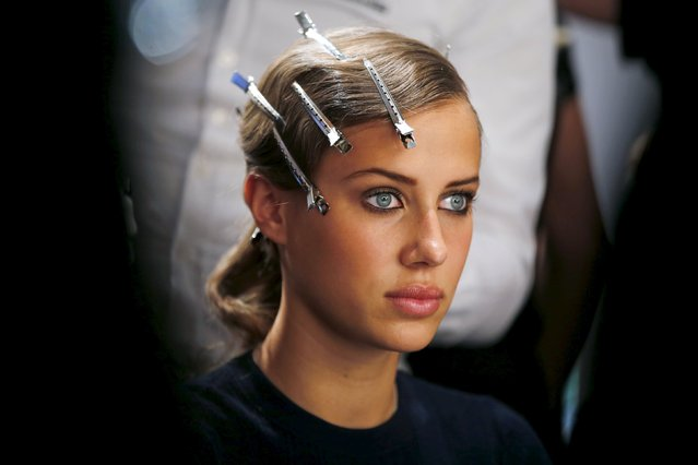 A model gets her hair made for the fashion show of Guido Maria Kretschmer at Berlin Fashion Week Spring/Summer 2016 in Berlin, Germany, July 8, 2015. (Photo by Fabrizio Bensch/Reuters)