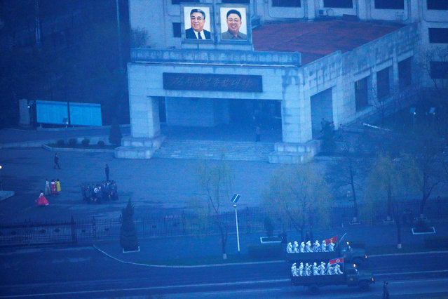 Military trucks carry soldiers through central Pyongyang before sunset as the capital preparers for a parade marking today's 105th anniversary of the birth of Kim Il Sung, North Korea's founding father and grandfather of the current ruler, April 15, 2017. (Photo by Damir Sagolj/Reuters)