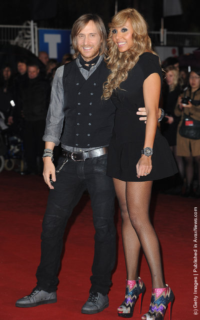David and Cathy Guetta pose as they arrive at NRJ Music Awards 2012 at Palais des Festivals