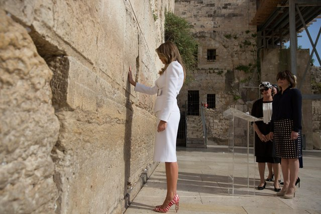 US First Lady Melania Trump touches the Western Wall, Judaism's holiest prayer site, in Jerusalem's Old City, 22 May 2017. President Trump and his contingent arrived for a 28-hour visit to Israel and the Palestinian Authority areas on his first foreign trip since taking office in January. (Photo by Heidi Levine/EPA)