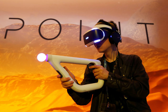 A man plays Sony Playstation's Farpoint Impulse Gear Virtual Reality game at the E3 Electronic Expo in Los Angeles, California, U.S. June 14, 2016. (Photo by Lucy Nicholson/Reuters)