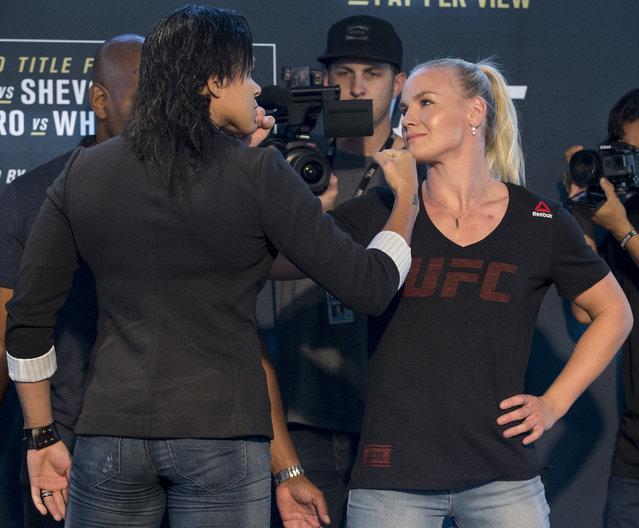 Amanda Nunes, left, and Valentina Shevchenko, pose during media day for Saturday's UFC 213, in Las Vegas on Thursday, July 6, 2017. (Photo by Erik Verduzco/Las Vegas Review-Journal via AP Photo)