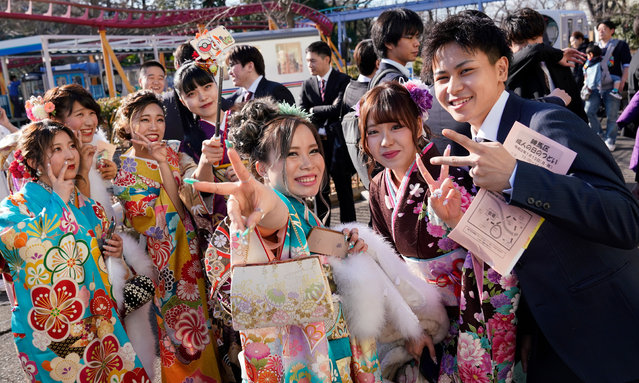Young Japanese women dressed in colorful kimonos gather for a ceremony marking the Coming of Age Day at Toshimaen Amusement Park in Tokyo, Japan, 13 January 2020. Coming of Age Day celebrates all those who reached 20 years of age, which is considered adulthood in Japan. (Photo by Christopher Jue/EPA/EFE)