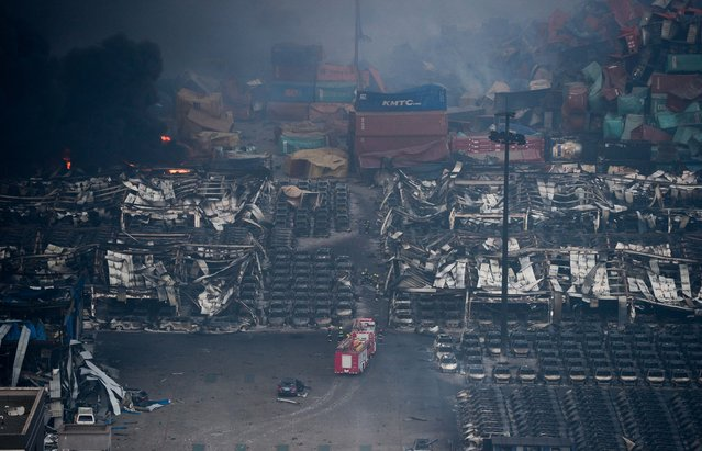 Rows of cars are burnt following the explosions of a warehouse in Binhai New Area on August 13, 2015 in Tianjin, China. (Photo by ChinaFotoPress/ChinaFotoPress via Getty Images)