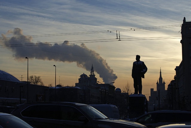A statue os Russian Soviet poet Vladimir Mayakovsky is silhouetted in downtown Moscow, Russia, Thursday, January 21, 2016. (Photo by Ivan Sekretarev/AP Photo)