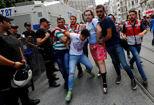 Plainclothes police officers detain LGBT rights activists as they try to gather for a pride parade, which was banned by the governorship, in Istanbul, Turkey, June 26, 2016. (Photo by Murad Sezer/Reuters)