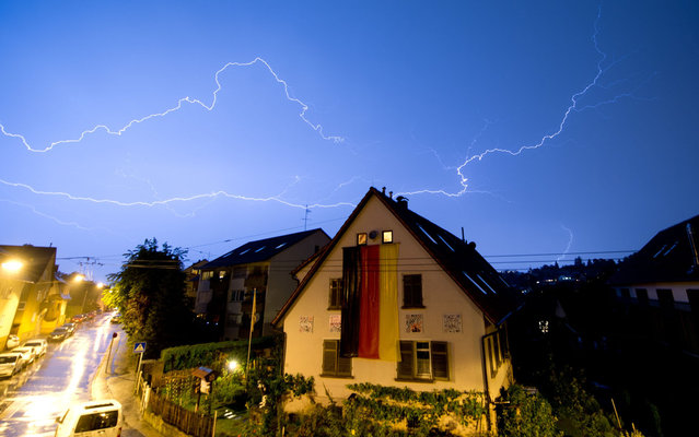 In this picture made available July 8, 2014 lightning flashes over the city of Stuttgart, Germany, Monday, July 7, 2014. (Photo by Sebastian Kahnert/AP Photo/DPA)
