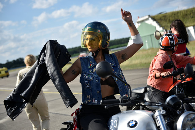 Participants prepare for a motorbike race at the women's-only Petrolettes motorcycle festival in Neuhardenberg near Berlin, Germany on July 29, 2017. (Photo by Stefanie Loos/Reuters)