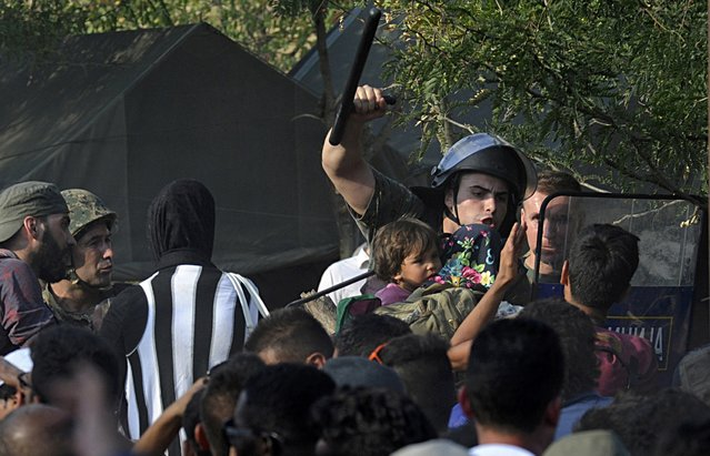 Migrants clash with Macedonian police at the Greek-Macedonian border, August 21, 2015. (Photo by Alexandros Avramidis/Reuters)