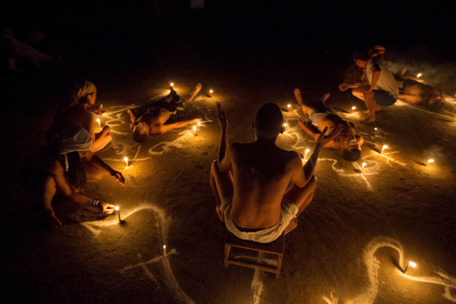 People take part in rituals at the Sorte Mountain on the outskirts of Chivacoa, in the state of Yaracuy, Venezuela October 10, 2015. (Photo by Marco Bello/Reuters)