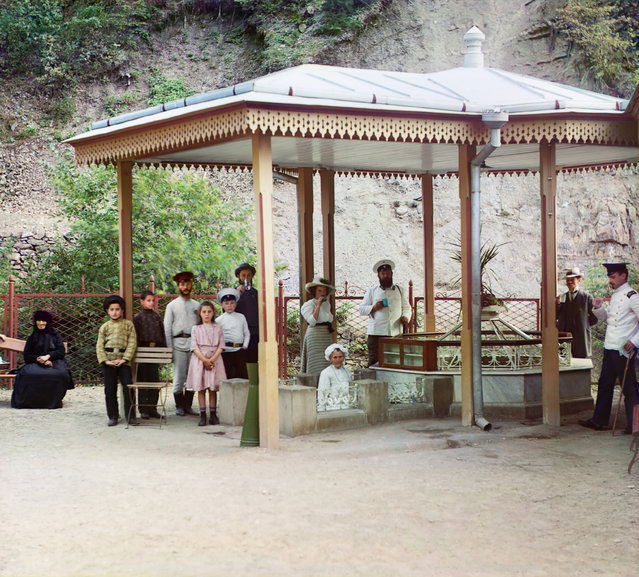 Photos by Sergey Prokudin-Gorsky. Evgeniev spring. Borzhom (Group of people standing near natural spring at a health resort; some are drinking the mineral water). Russia, Tiflis province, Gori district, Borjomi, 1912