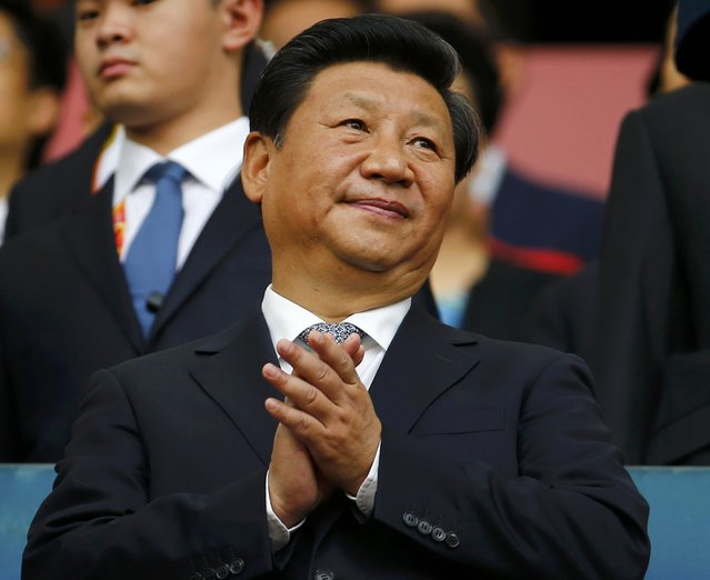 Chinese President Xi Jinping applauds during the opening ceremony of the 15th IAAF World Championships at the National Stadium in Beijing, China August 22, 2015. (Photo by Damir Sagolj/Reuters)