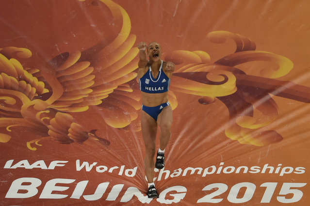 """Greece's Nikoleta Kyriakopoulou reacts during the final of the women's pole vault athletics event at the 2015 IAAF World Championships at the """"Bird's Nest"""" National Stadium in Beijing on August 26, 2015. (Photo by Antonin Thuillier/AFP Photo)"""