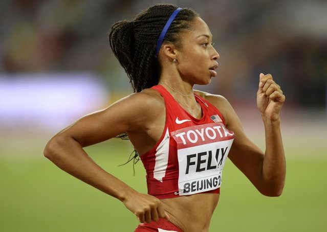Allyson Felix of U.S. (R) leads the pack to win the women's 400 metres final during the 15th IAAF World Championships at the National Stadium in Beijing, China August 27, 2015. (Photo by Dylan Martinez/Reuters)