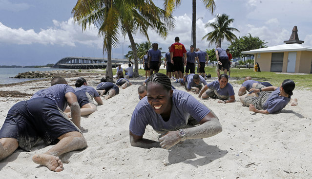 Miami Police Academy Class, PAC, 106 perform team building exercises at Hobie Beach in Key Biscayne, Fla., Wednesday, August 20, 2014. (Photo by Alan Diaz/AP Photo)