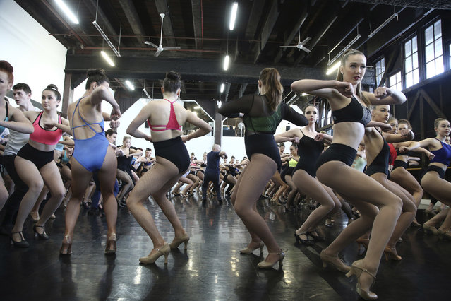 "Auditioning performers follow resident choreographer Erik Sorensen, center back, at the Sydney Dance Company in a routine during castings in Moulin Rouge's current show ""Féerie"", in Sydney, Australia, Thursday, July 28, 2016. (Photo by Rob Griffith/AP Photo)"