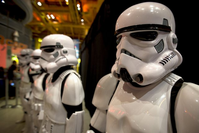 """People dressed as Storm Trooper characters from """"Star Wars"""" await people to purchase toys that are to go on sale at midnight in advance of the film """"Star Wars: The Force Awakens"""" in Times Square in the Manhattan borough of New York, September 3, 2015. (Photo by Carlo Allegri/Reuters)"""