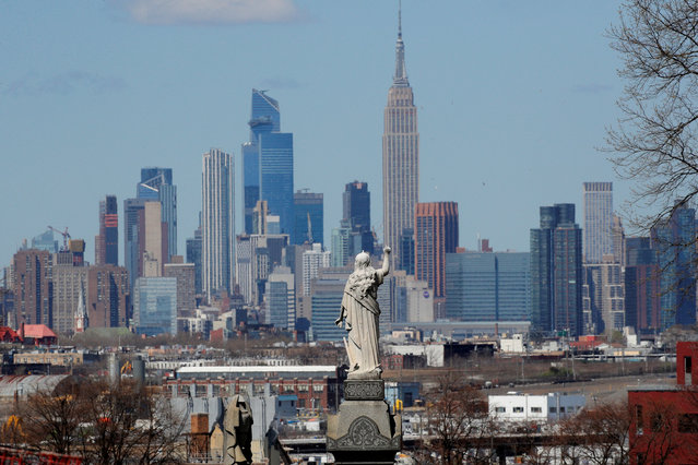 A view of the Manhattan skyline as seen from the Linden Hill Cemetery during the outbreak of the coronavirus disease (COVID-19) in the Brooklyn borough of New York City, New York, U.S., April 6, 2020. (Photo by Brendan Mcdermid/Reuters)