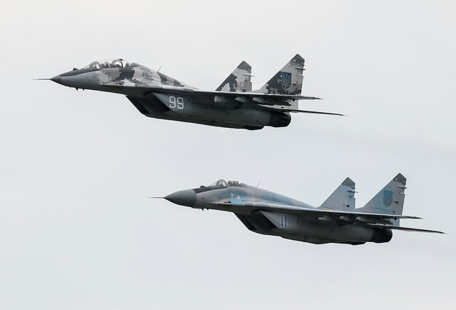 MIG-29 fighter aircrafts fly at a military air base in Vasylkiv, Ukraine, August 3, 2016. (Photo by Gleb Garanich/Reuters)