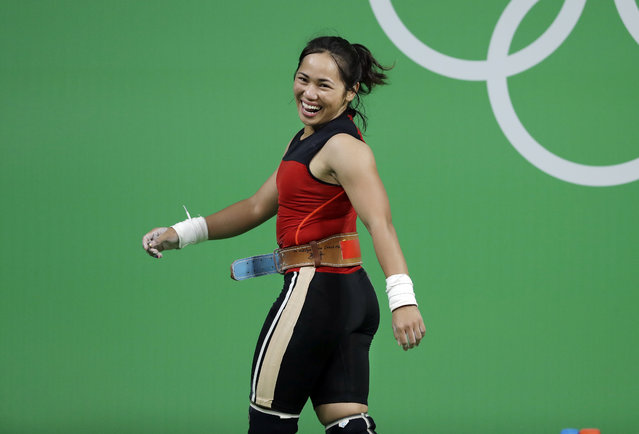 Hidilyn Diaz, of the Philipines, laughs as she leaves the stage after a lift in the women's 53kg weightlifting competition at the 2016 Summer Olympics in Rio de Janeiro, Brazil, Sunday, August 7, 2016. (Photo by Mike Groll/AP Photo)