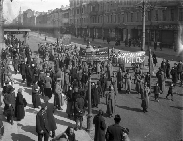 In this photo taken in Oct. 1917, provided by Russian State Archive of Social and Political History, soldiers cary a revolutionary banner as they march in Liteiny prospekt in St. Petersburg, Russia. The 1917 Bolshevik Revolution was long before the digital revolution allowed anyone to instantly document events. But the clumsy cameras of the time still caught some images that capture the period's drama. (Photo by Russian State Archive of Social and Political History via AP Photo)