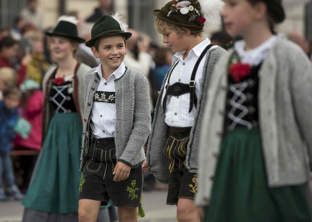 Young people dressed in traditional Bavarian clothes take part in the Oktoberfest parade in Munich, Germany, September 20, 2015. (Photo by Lukas Barth/Reuters)
