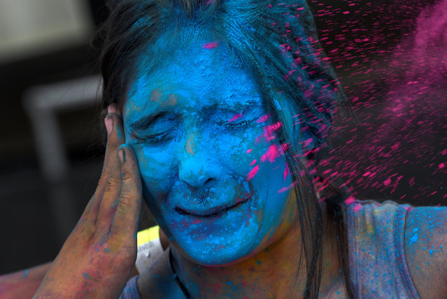 A reveller takes part in the Holi Party Festival at Niemeyer Center in Aviles, northern Spain, August 27, 2016. (Photo by Eloy Alonso/Reuters)