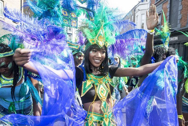 People in traditional carnival costumes parade through the streets of Notting hill in West London in the biggest carnival in Europe on August 28, 2016. (Photo byMark Thomas/i-Images)