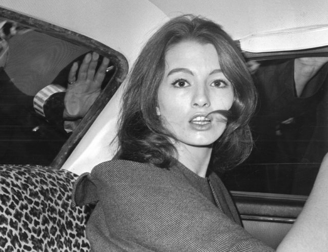 In this file photo dated  July 22, 1963 Christine Keeler, a principal witnesses in the vice charges case against osteopath Dr. Stephen Ward.  The model at centre of Profumo Affair, a scandal that rocked the political establishment and forced cabinet minister to resign, has died Tuesday Dec. 5, 2017, according to a statement issued by her family. (Photo by AP Photo)
