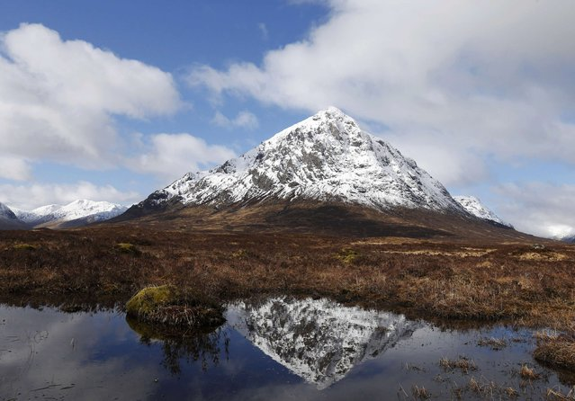 The mountain Buachaille Etive Mor is reflected in water near Ballachulish, Scotland, Britain March 9, 2016. (Photo by Russell Cheyne/Reuters)
