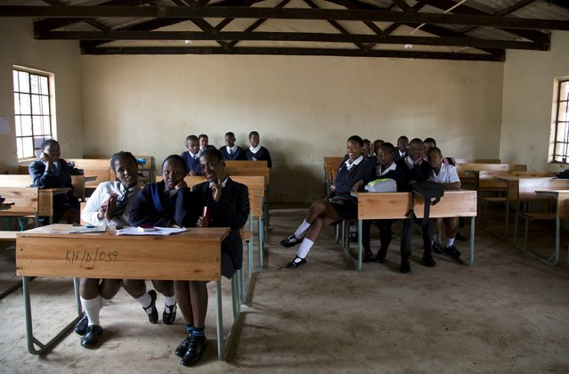 A 12th grade class at Khabazela High School pose for a picture in their classroom in eMbo, west of Durban, South Africa, September 23, 2015. (Photo by Rogan Ward/Reuters)