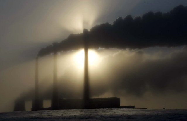 A heating plant is seen on a winter's morning in Minsk, Belarus,  as temperatures fell to minus 5.8 degree Fahrenheit on February 1, 2012. (Photo by Sergei Grits/Associated Press)