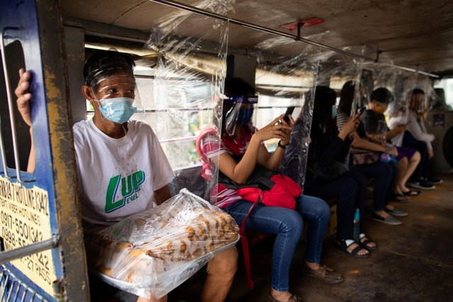 Jeepney passengers seated between plastic barriers, wear face masks and face shields mandatory in public transportation, to help curb coronavirus disease (COVID-19) infections, in Quezon City, Metro Manila, Philippines, August 19, 2020. (Photo by Eloisa Lopez/Reuters)
