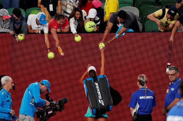 Belgium's Elise Mertens signs autographs after winning her match against Australia's Daria Gavrilova on day three of the Australian Open tennis tournament in Melbourne early January 18, 2018. (Photo by Issei Kato/Reuters)