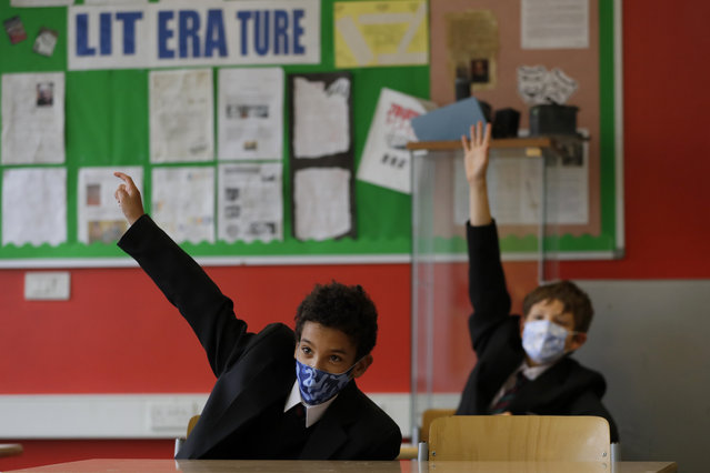 Year seven pupils Henry Holness, left, and Eddie Favell in class during their first day at Kingsdale Foundation School in London, Thursday, September 3, 2020. Schools in England are starting to reopen with special measures in place to deal with Coronavirus. (Photo by Kirsty Wigglesworth/AP Photo)