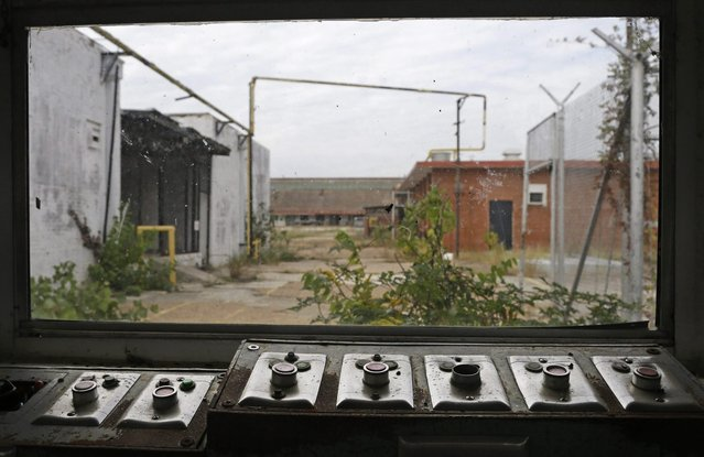 In this October 23, 2014, photo, buttons that used to open and close many of the gates sit with a view of some of the out buildings at the abandoned Central State Farm prison in Sugar Land, Texas. The unit was closed down three years ago. (Photo by Pat Sullivan/AP Photo)