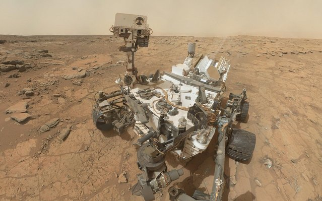 """Self-portrait of the rover Curiosity, combining dozens of exposures taken by the rover's Mars Hand Lens Imager (MAHLI) during the 177th Martian day, or sol, is seen in this February 3, 2013 handout image courtesy of NASA. The rover is positioned at a patch of flat outcrop called """"John Klein"""", which was selected as the site for the first rock-drilling activities by Curiosity. The rover's robotic arm is not visible in the mosaic. (Photo by NASA)"""