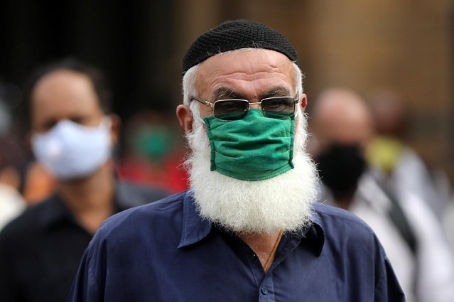 A man wearing a protective mask exits a railway station amidst the spread of the coronavirus disease (COVID-19) in Mumbai, India, September 9, 2020. (Photo by Francis Mascarenhas/Reuters)