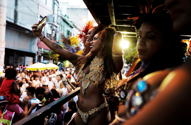 "Women take part in an annual block party known as ""Banda do Candinho e Mulatas"" (Candinho Band and Mulatto Women), during carnival festivities at Bixiga neighbourhood in Sao Paulo, Brazil February 7, 2018. (Photo by Nacho Doce/Reuters)"