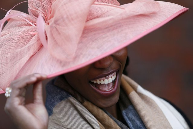 A racegoer smiles during Ladies Day, the second day of racing at the Cheltenham Festival horse racing meet in Gloucestershire, western England March 13, 2013. (Photo by Stefan Wermuth/Reuters)