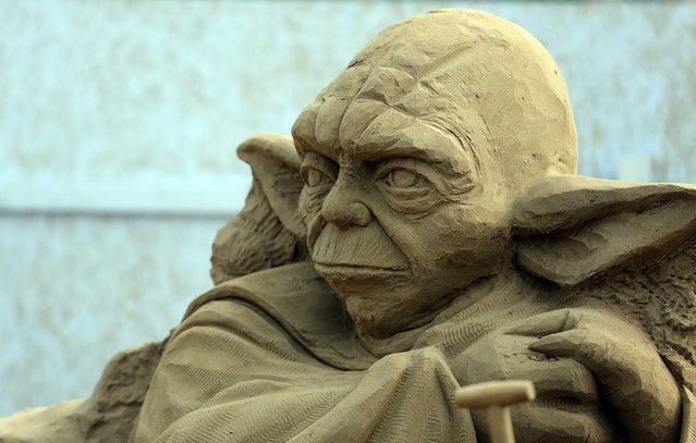 Detail of a sand sculpture of Yoda is seen as pieces are prepared as part of this year's Hollywood themed annual Weston-super-Mare Sand Sculpture festival on March 26, 2013 in Weston-Super-Mare, England. Due to open on Good Friday, currently twenty award winning sand sculptors from across the globe are working to create sand sculptures including Harry Potter, Marilyn Monroe and characters from the Star Wars films as part of the town's very own movie themed festival on the beach.  (Photo by Matt Cardy)