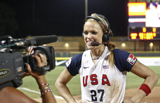 """In this Monday, July 26, 2010 file photo, USA's Jennie Finch talks with the media following the World Cup of Softball Championship game against Japan in Oklahoma City. A former contestant on the reality television show """"The Apprentice"""", Finch says the show's star, Donald Trump, """"was extremely supportive. You could tell there was so much respect there on all sides, especially with the female athletes. … Obviously, he was complimentary, but never in an inappropriate way"""". (Photo by Alonzo Adams/AP Photo)"""