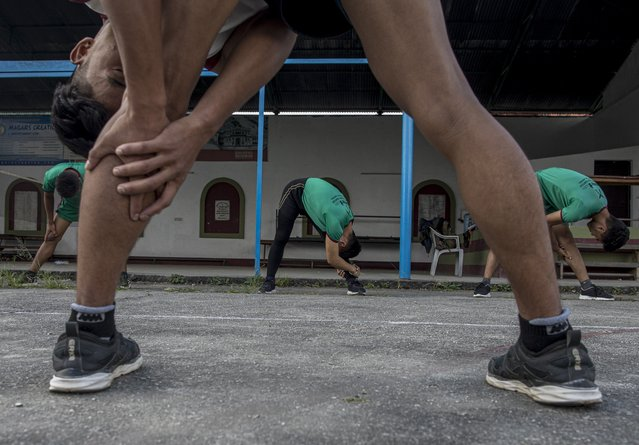 Nepalese youths participate in a physical training session amid coronavirus pandemic at the Gurkha AXN training institute in Kathmandu, Nepal, 12 October 2020. The British Army will recruit 340 Nepalese youths from the 540 finalist youths under age of 18 years which has selected from all over the Nepal. Those selected will join the elite regiment of Brigade of Gurkhas under the British Army. The British Gurkha soldier recruitment selection process will take place in January 2021 at British Gurkha camp situated in Pokhara City, Nepal. (Photo by Narendra Shresha/EPA/EFE)
