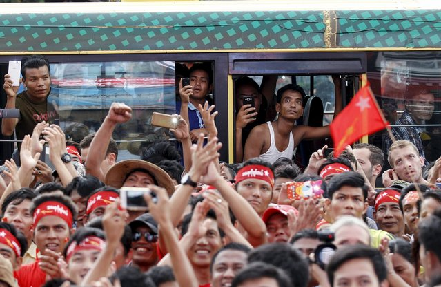 Supporters look at an LED screen as they wait for official results from the Union Election Commission in front of the National League for Democracy Party (NLD) head office at Yangon, November 9, 2015. (Photo by Soe Zeya Tun/Reuters)
