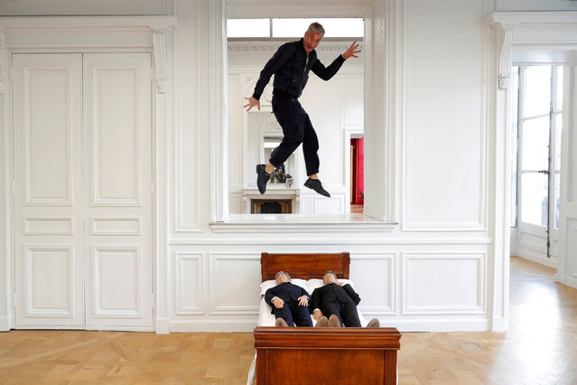 "Italian artist Maurizio Cattelan poses with his creation ""Is There Life Before Death"" (2010), prior to the opening of the exhibition ""Not Afraid of Love"" at the Hotel de la Monnaie in Paris, France, October 17, 2016. From October 21, 2016 to January 8, 2017, ""Not Afraid of Love"", curated by Chiara Parisi, director of Cultural Programs, sets Maurizio Cattelan's ""comeback at work"" in one of the most beautiful Palaces on the river Seine. The exhibition comes together with the publication of an artist book entirely conceived by Maurizio Cattelan and published by Monnaie de Paris, also some special coin editions are created by the artist in the engraving workshops of Monnaie de Paris. (Photo by Philippe Wojazer/Reuters)"
